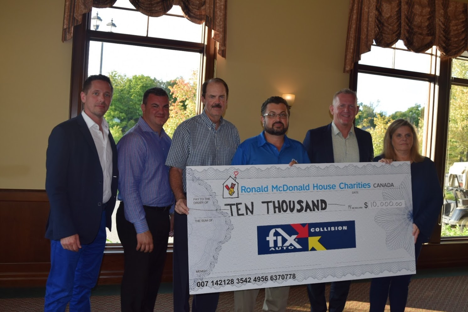 Fix Auto Canada Ten Thousand Dollar Cheque Presentation.